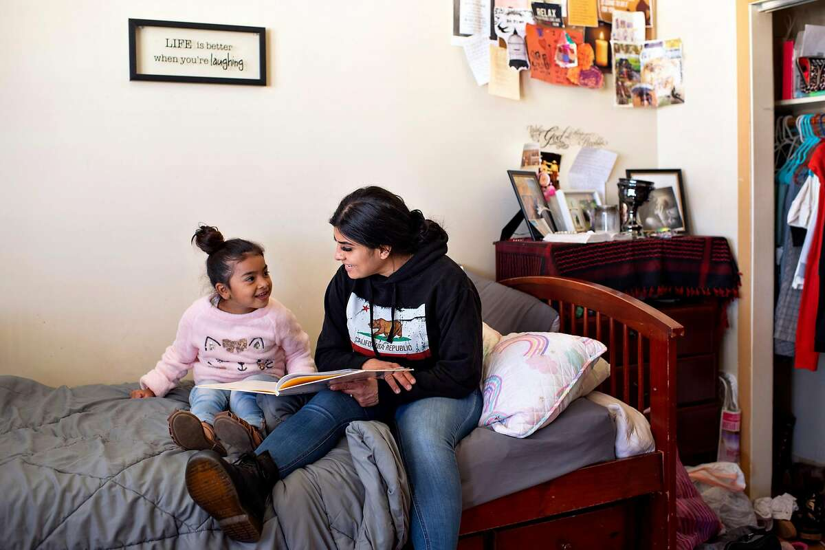 Daisy Gonzalez reads a book to daughter Mireyah Pelayo, 6, at Cameo House, a long-term transitional and alternative sentencing program in San Francisco.