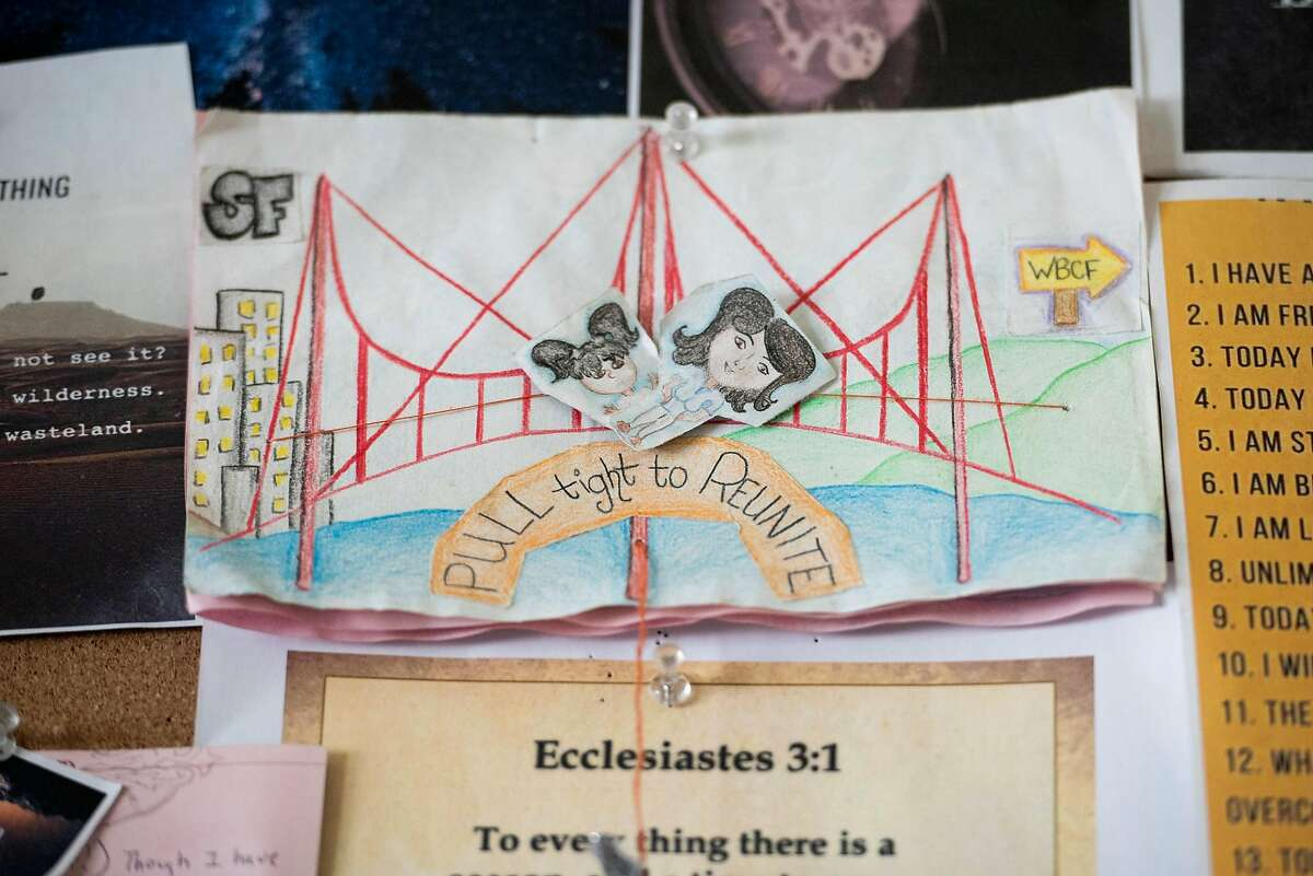 A drawing made by Daisy Gonzalez when she was incarcerated, depicting being reunited with her daughter, Mireyah Pelayo, 6, hangs on her wall at Cameo House, a long-term transitional and alternative sentencing program for homeless, formerly incarcerated women and children, in San Francisco.