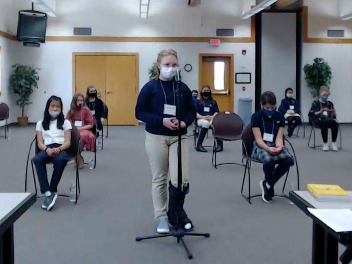 Annabelle Kieszkowski answers a question at the10th Annual Diocesan Catechism Bee at the Diocesan Pastoral Center in Gaylord on Thursday. (Screenshot/YouTube)