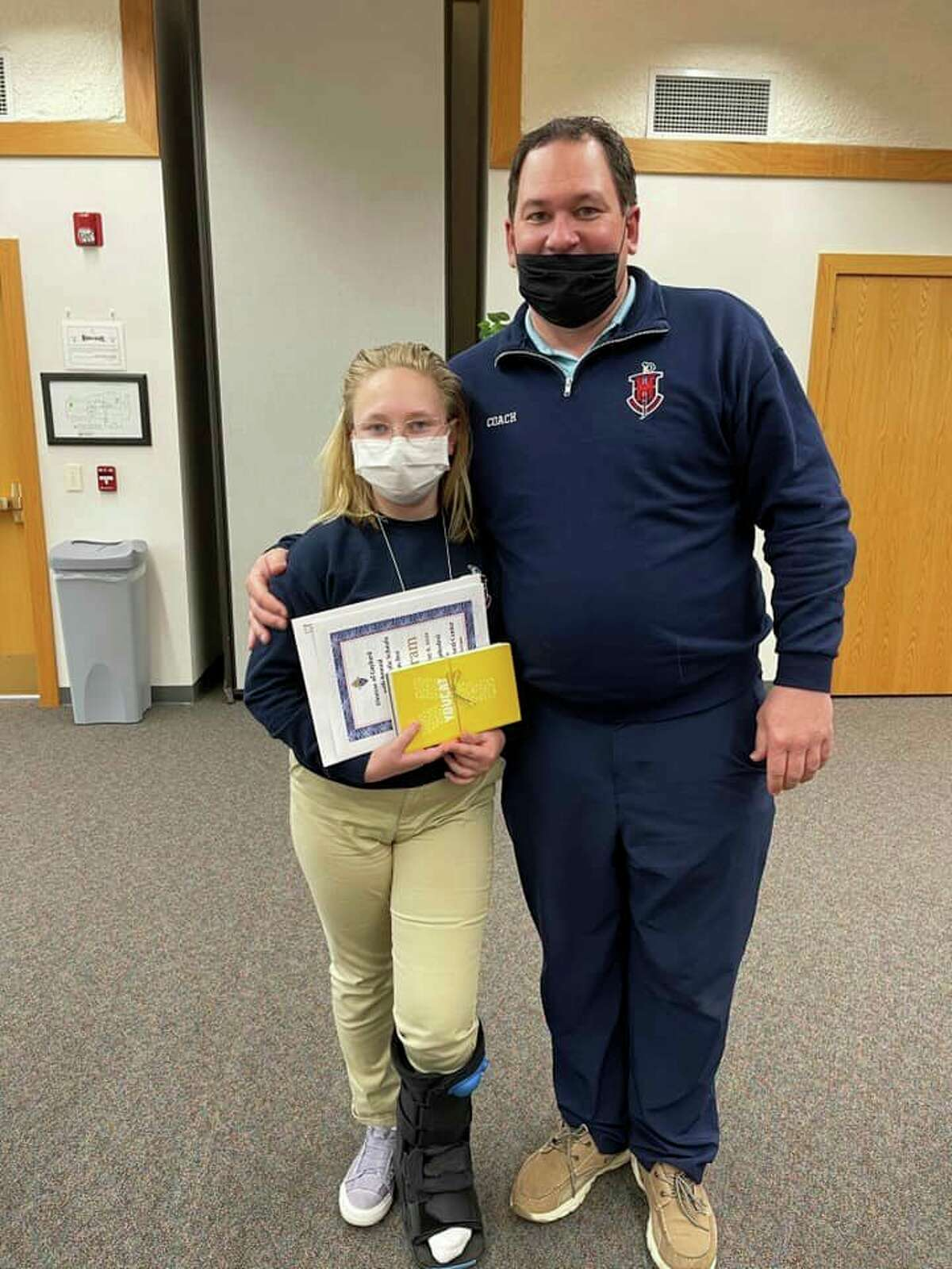 AnnabelleKieszkowski and her father, Ryan, pose for a photo after Annabelle's ninth-place finish at the10th Annual Diocesan Catechism Bee in Gaylord on Thursday. (Courtesy photo)