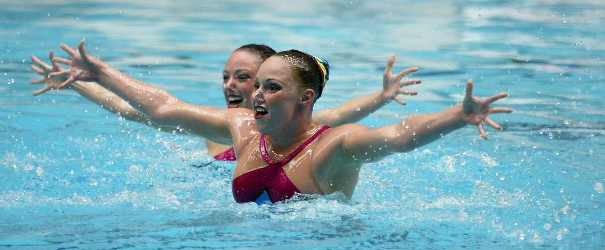Olympians Courtenay Stewart, left, and Sara Lowe, of Stanford University perform their techincal duet at the 2005 AFLAC US National Synchronized Swimming Championships at the King County Aquatic Center in Federal Way, WA on April 28,2005. Sara won a bronze medal at the 2004 Athens Olympics.