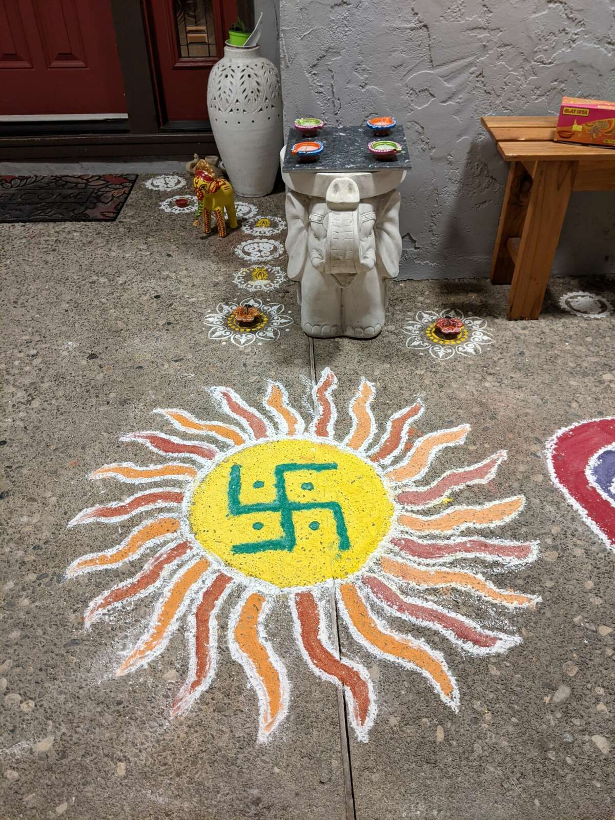 A Hindu swastika decorates the New York patio of a home where a Hindu wedding ceremony unfolds. The curving swastika with its rounded corners is an ancient symbol of good fortune and often used on wedding invitations and gift wrap.