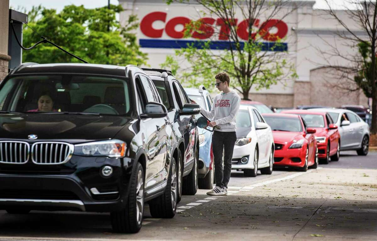 Numerous vehicles line up for gasoline at Costco on Wendover Avenue in Greensboro, N.C., on Tuesday, May 11, 2021. As the shutdown of a major fuel pipeline entered into its fifth day, efforts are under way to stave off potential fuel shortages, though no widespread disruptions were evident. The Colonial Pipeline, which delivers about 45% of the fuel consumed on the East Coast, was hit by a cyberattack on Friday. (Woody Marshall/News & Record via AP)