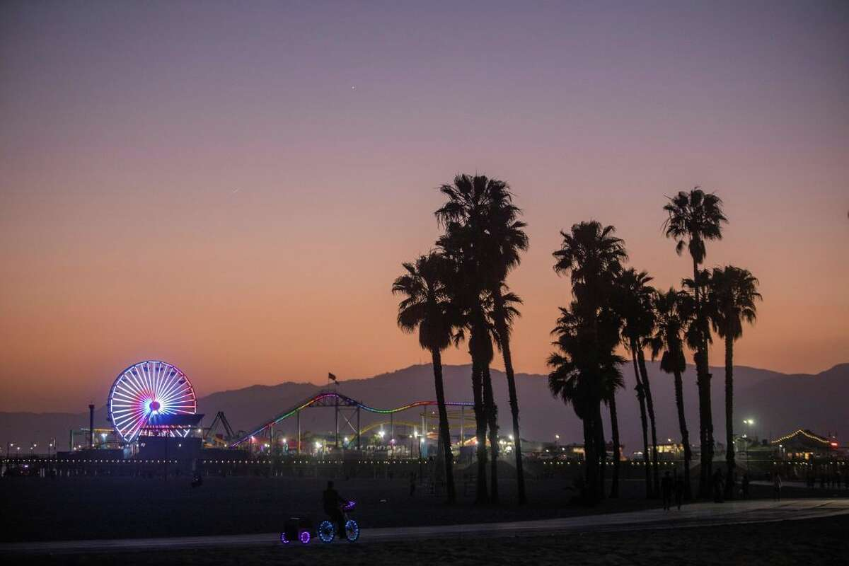 A man rides his bike during the first day of the Memorial Day holiday weekend in Santa Monica, Calif., on May 23, 2020.