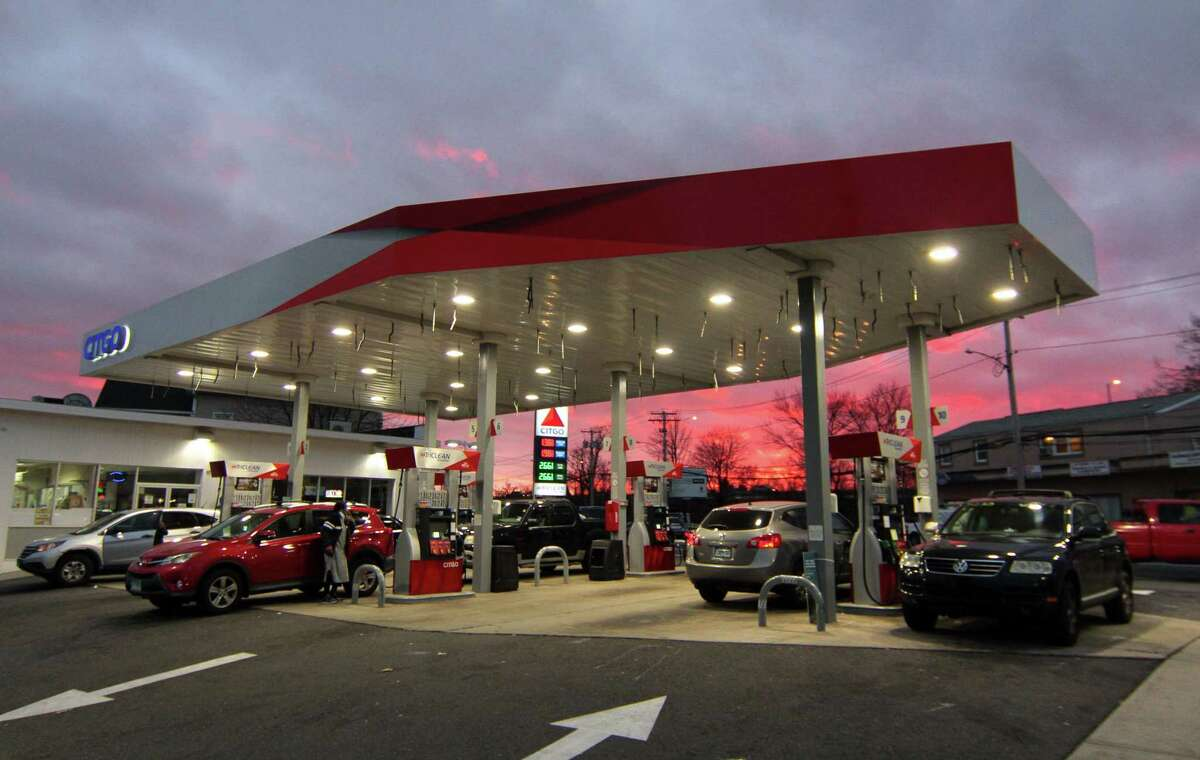 Customers get gas at the Citgo station along Housatonic Avenue in Bridgeport, Conn.