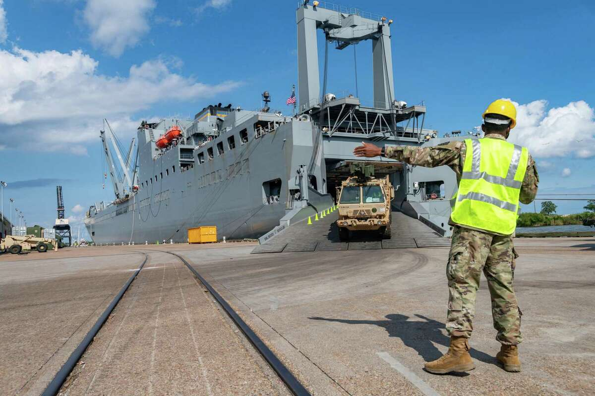 A soldier directs a vehicle disembarking from the USNS Frazier. If you're seeing a lot of soldiers and Army vehicles, on the streets of Port Arthur, do not be alarmed. About a thousand soldiers of The 7th Transportation Brigade (Expeditionary) of the US Army also known as the
