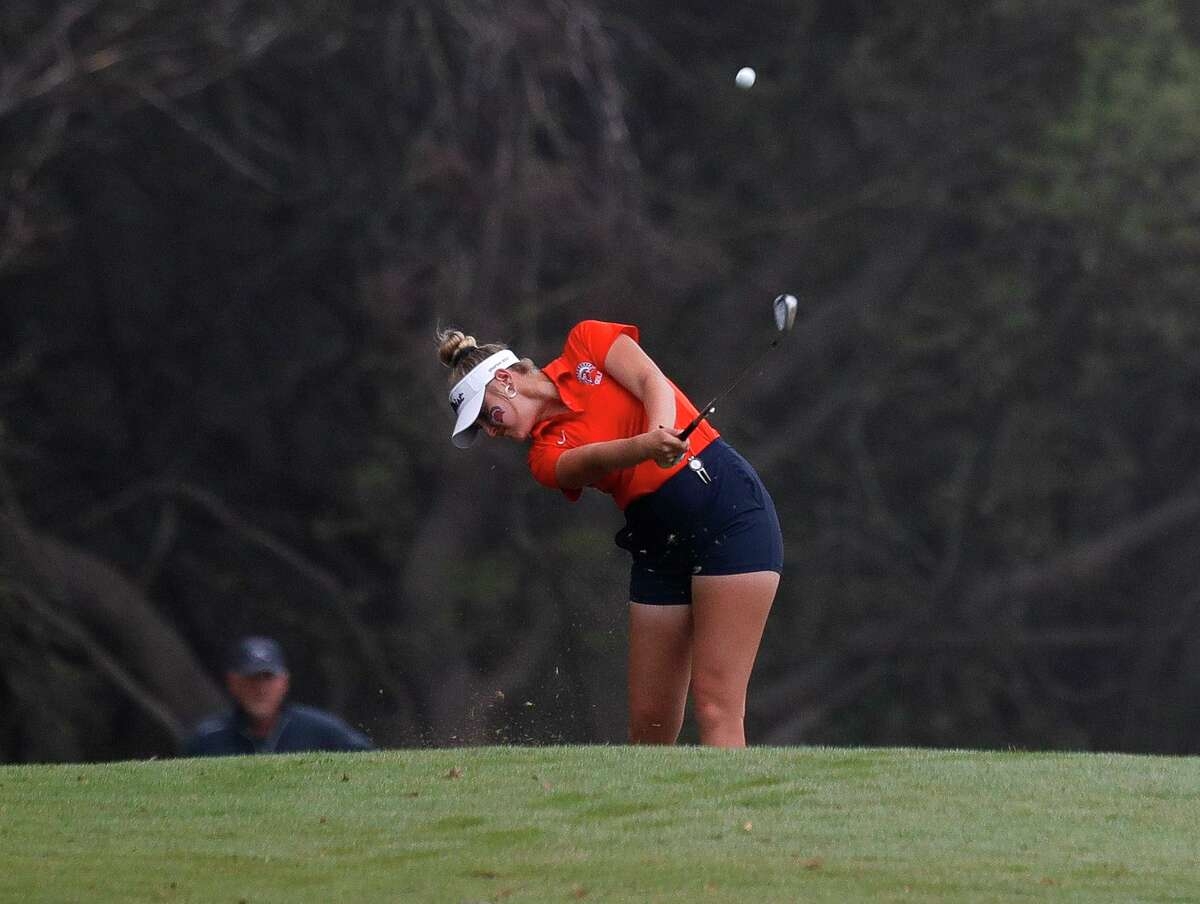 Grayson Heilman of Seven Lakes hits her second shot toward the 9th green during the Class 6A girls UIL State Golf Championship at Legacy Hills Golf Club, Tuesday, May 11, 2021, in Georgetown.