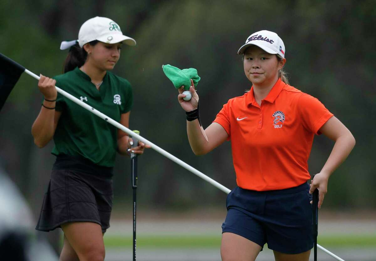 Maelynn Kim of Seven Lakes acknowledges applauses after sinking a putt on the 9th green in light fog during the Class 6A girls UIL State Golf Championship at Legacy Hills Golf Club, Tuesday, May 11, 2021, in Georgetown.