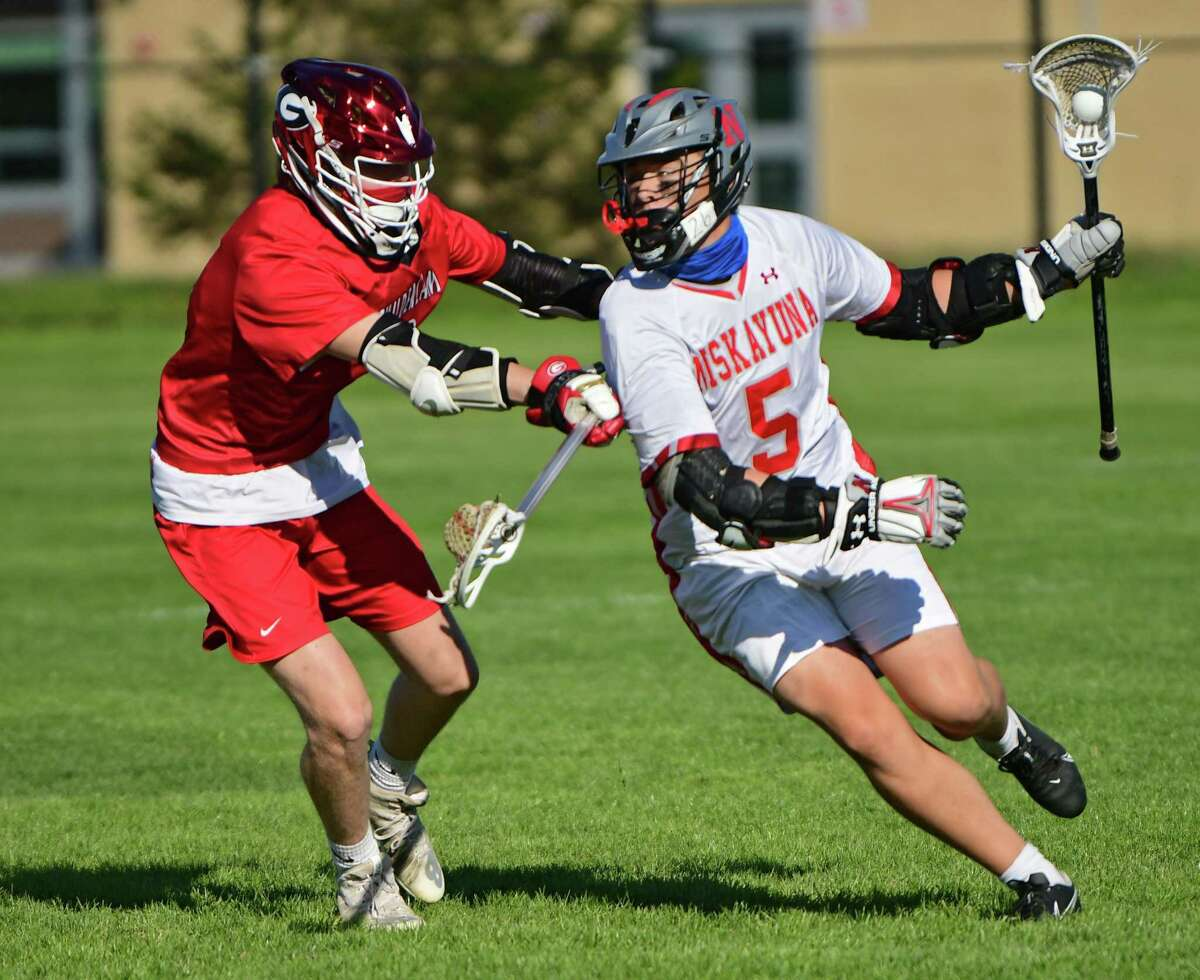 Niskayuna's Greyson Vorgang, right, is defended by Guilderland's Will Angus during a lacrosse game on Tuesday, May 11, 2021 in Niskayuna, N.Y. (Lori Van Buren/Times Union)