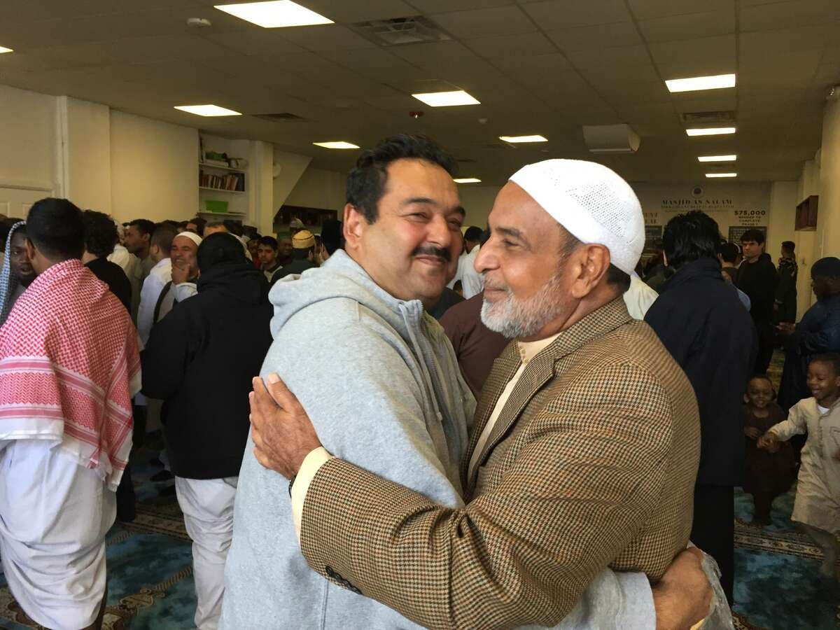 Two men greet each other for Eid at Masjid As-Salam on June 4, 2019. (Courtesy: Masjid As-Salam)