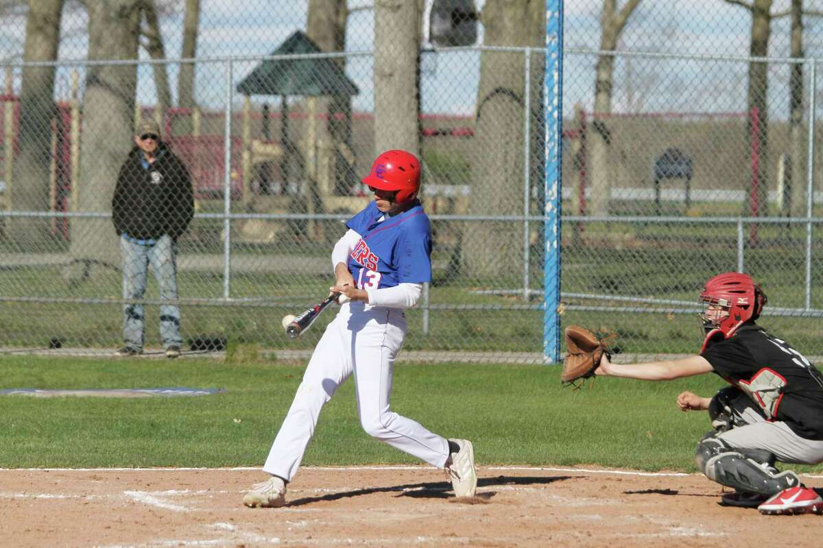 Manistee Catholic Central's Lee Pizana connects for a hit during the Sabers' sweep of Walkerville this spring. (News Advocate file photo)