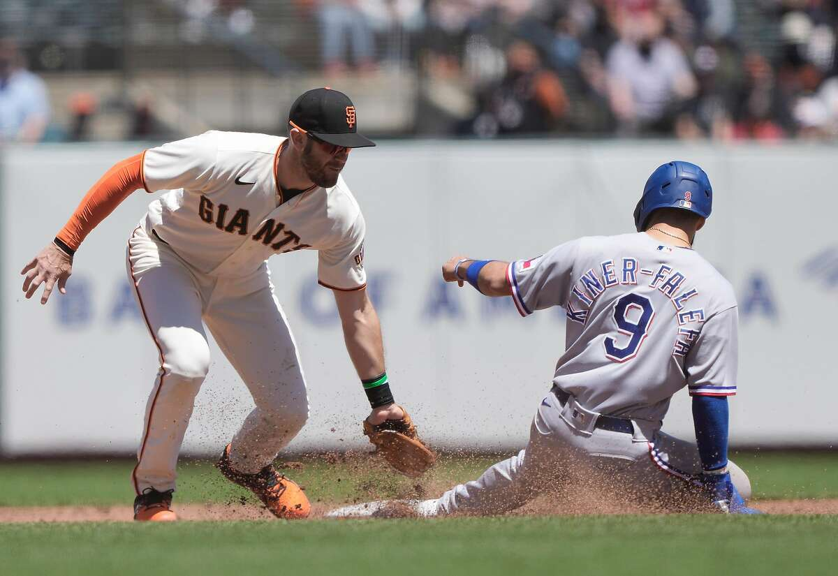 Texas' Isiah Kiner-Falefa steals second base sliding in ahead of the tag from Evan Longoria at Oracle Park on Tuesday.
