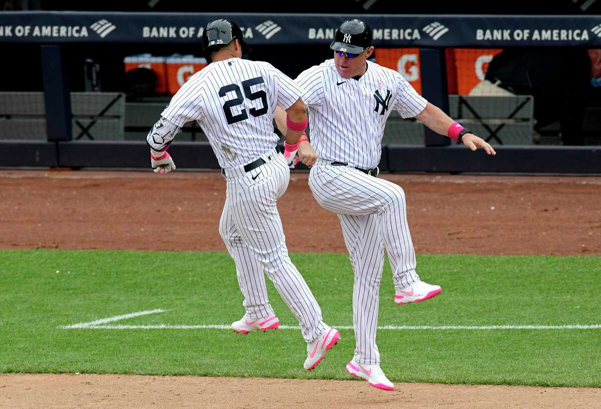 Yankees third-base coach Phil Nevin (right), here congratulating Gleyber Torres after a home run Sunday, is under quarantine protocol in Tampa after a positive COVID-19 test.