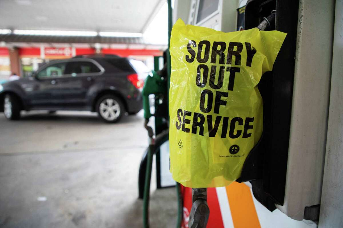 """An """"Out Of Service"""" bag covers a gas pump as cars continue line up for the chance to fill their gas tanks at a Circle K near uptown Charlotte, North Carolina on May 11, 2021 following a ransomware attack that shut down the Colonial Pipeline. Fears the shutdown of a major fuel pipeline would cause a gasoline shortage led to some panic buying and prompted US regulators on Tuesday to temporarily suspend clean fuel requirements in three eastern states and the nation's capital."""