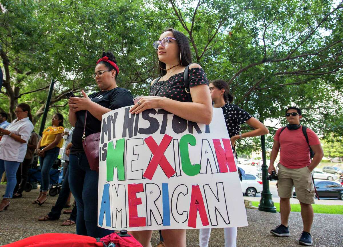 """Nati Roman, of the Somos Chicanx student group at San Antonio College joins protesters who gathered during a """"Protest the Name Change/Keep Mexican American Studies"""" Rally and Press Conference before the Texas State Board of Education in 2018."""