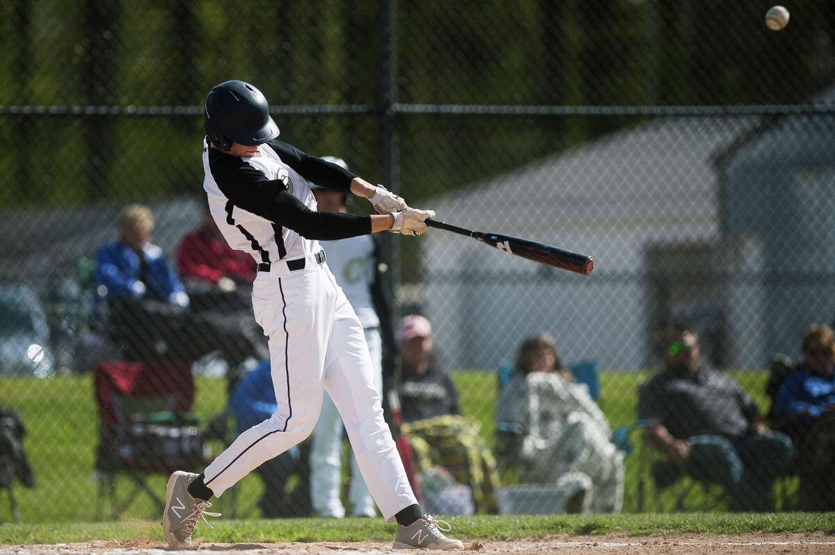 Bullock Creek's Jacob Wanous swings on a pitch during a game against Hemlock Tuesday, May 11, 2021 at Bullock Creek High School. (Katy Kildee/kkildee@mdn.net)