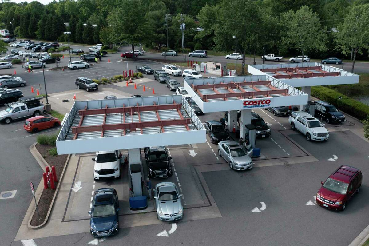 Gas customers swarm a COSTCO gas station amid fears of a gas shortage in Richmond, Va., Tuesday, May 11, 2021. The line at the facility extended around the entire building. (AP Photo/Steve Helber)