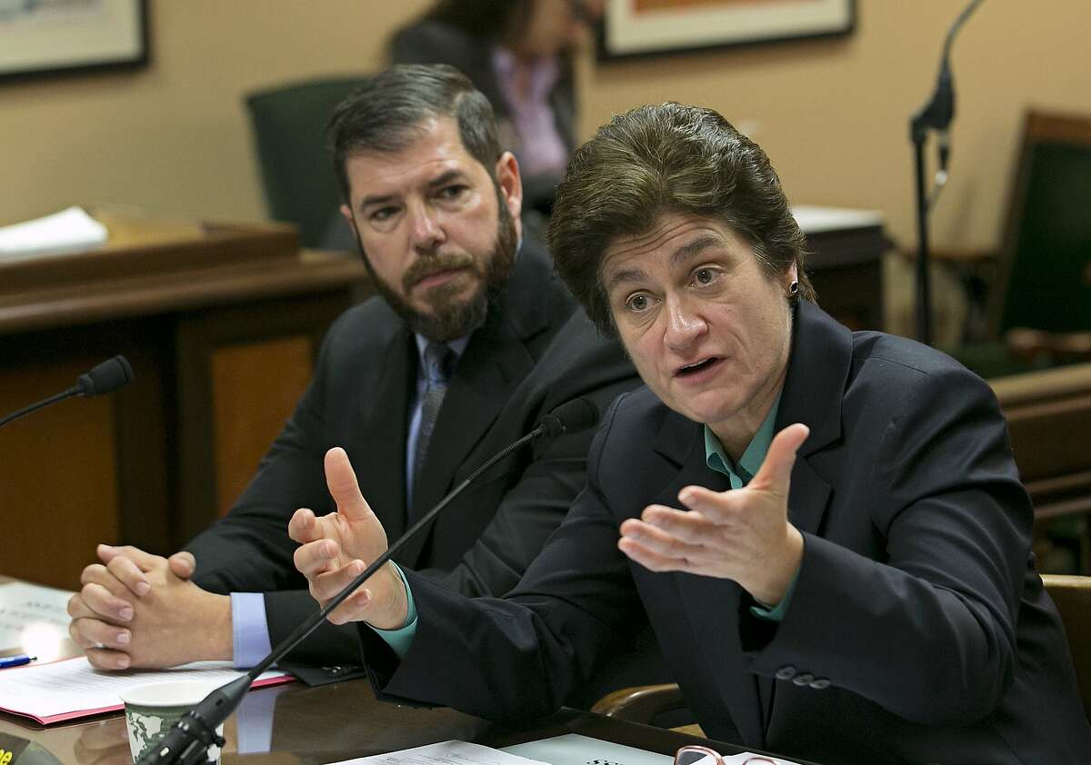 State Auditor Elaine Howle, right, at a state legislative hearing in January 2018 in Sacramento. At left is Democratic Assembly Member Joaquin Arambula. On Tuesday, Howle said in an audit that California's new and fully online community college, Calbright, has graduated just 12 of its more than 900 students, seen 384 of them drop out and lost track of another 87.