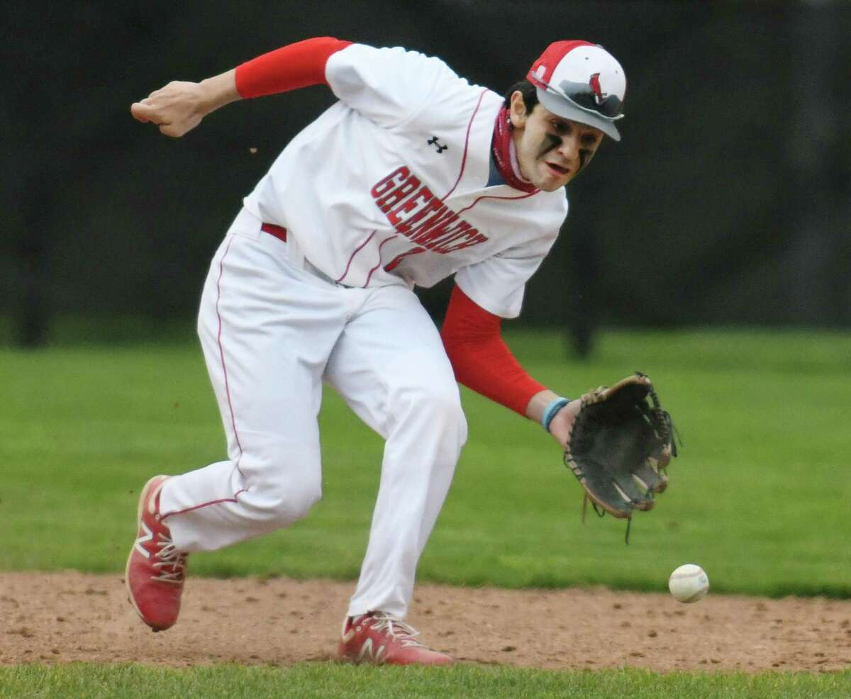 Greenwich shortstop Christian Mingione fields a ground ball in the high school baseball game between Greenwich and Trumbull at Greenwich High School in Greenwich, Conn. Tuesday, May 11, 2021.