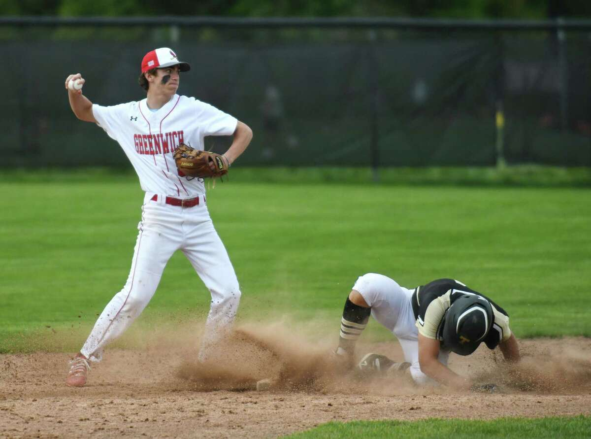 Greenwich second baseman Auggie Bancroft attempts to turn a doubleplay as Trumbull baserunner Jake Gruttadauria slides into second base in the high school baseball game between Greenwich and Trumbull at Greenwich High School in Greenwich, Conn. Tuesday, May 11, 2021.