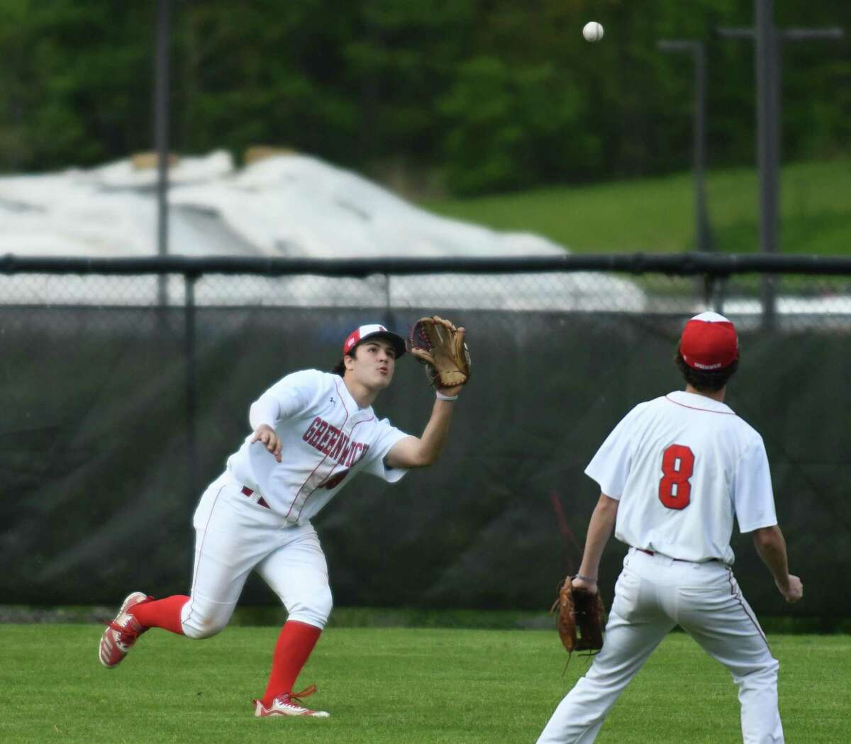 Greenwich right fielder Ryan Perez makes a catch in the high school baseball game between Greenwich and Trumbull at Greenwich High School in Greenwich, Conn. Tuesday, May 11, 2021.