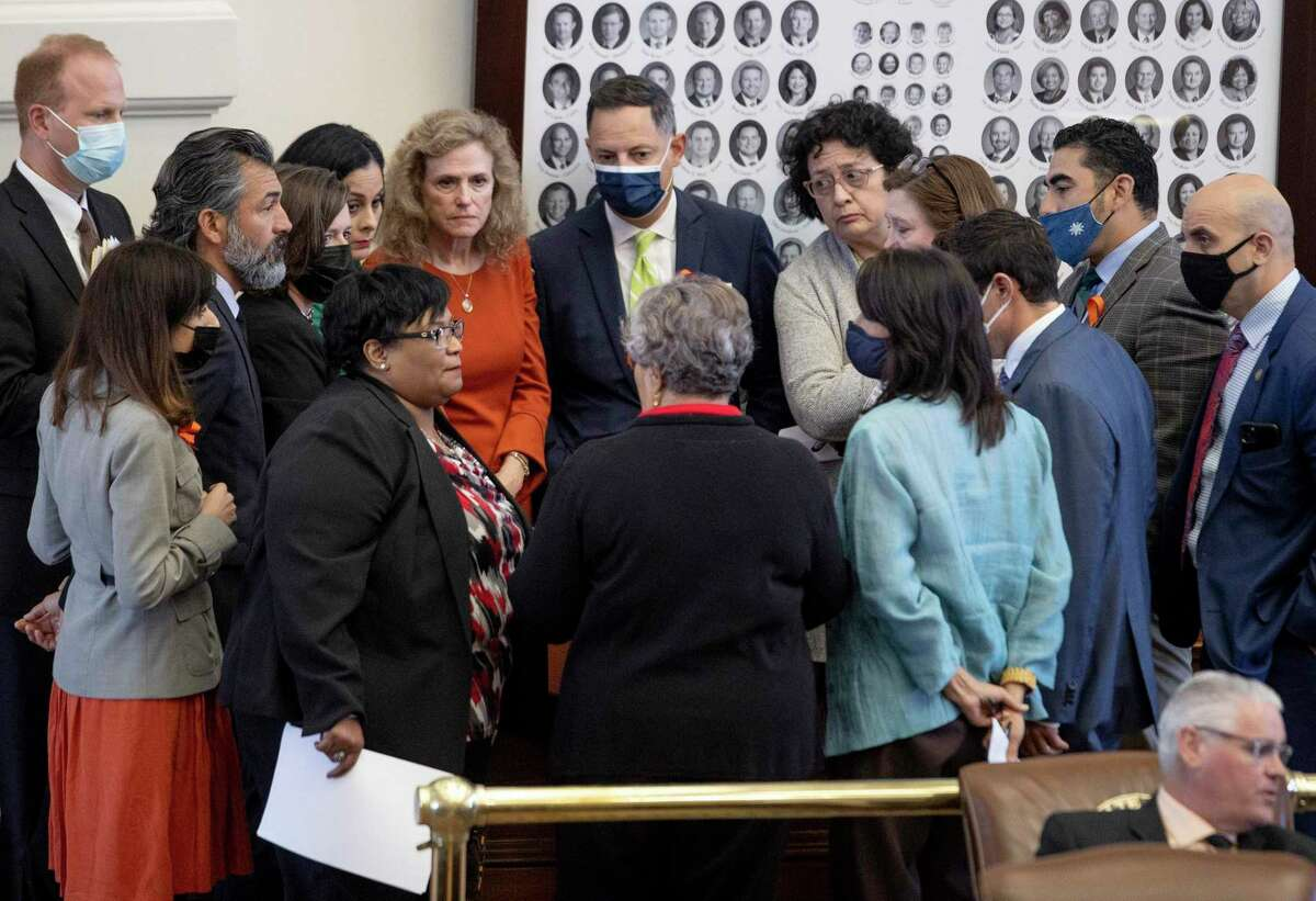 State representatives who are against Senate Bill 8, the fetal heartbeat bill, gather during a debate of the bill in the House chamber at the Capitol on Wednesday, May 5, 2021, in Austin, Texas. (Jay Janner/Austin American-Statesman via AP)