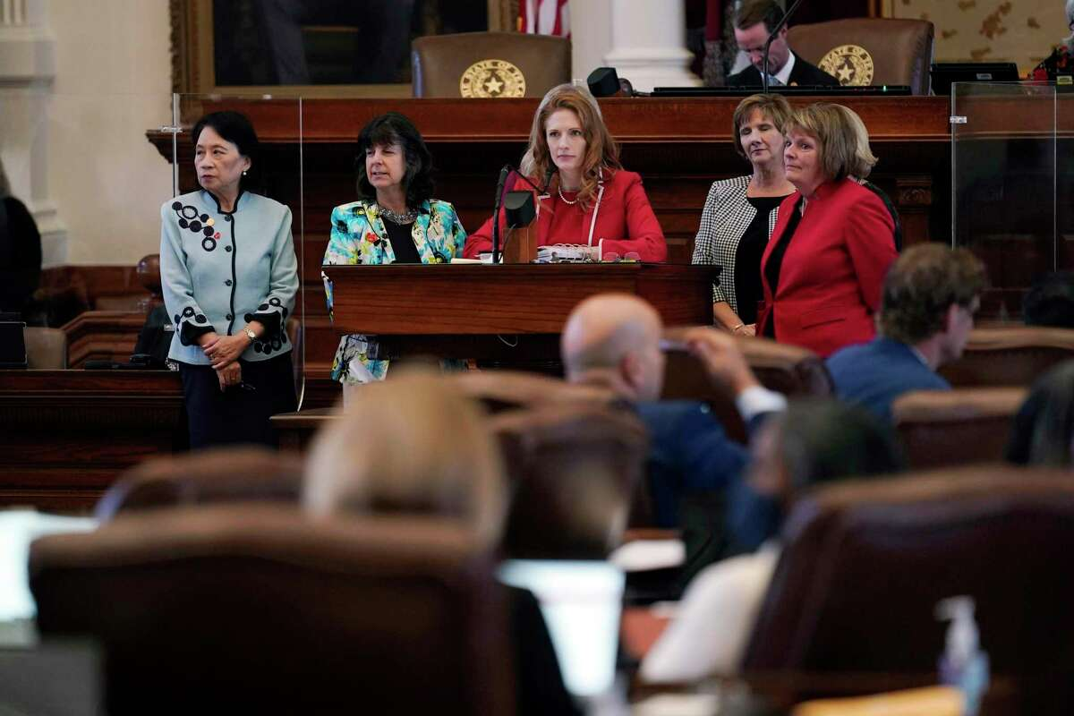 """Texas state Rep. Shelby Slawson, R-Stephenville, center, stands with co-sponsors as she answers questions about a proposed bill in the House Chamber, Wednesday, May 5, 2021, in Austin, Texas. Slawson is co-sponsoring a bill introduced in Texas that would ban abortions as early as six weeks and allow private citizens to enforce it through civil lawsuits, under a measure given preliminary approval by the Republican-dominated House. The move would have Texas join about a dozen other Republican-led states to pass so-called """"heartbeat bills"""" which have been mostly blocked by federal courts."""
