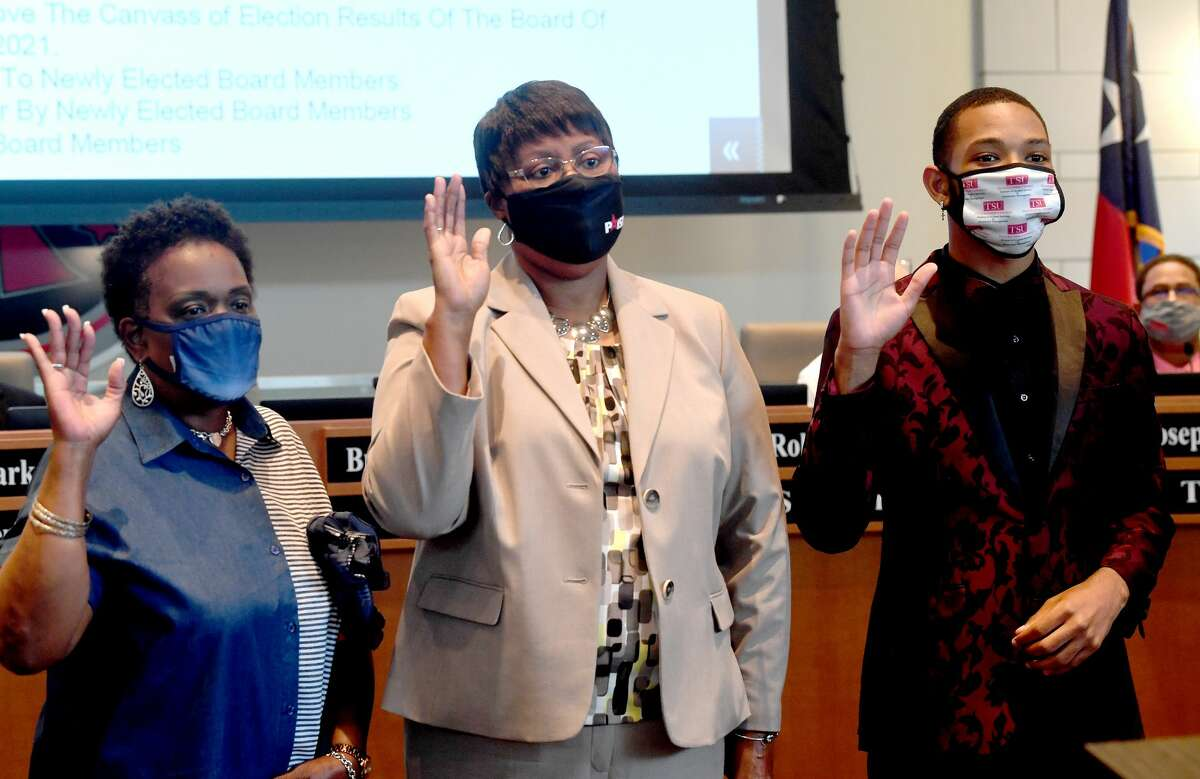 Taylor Getwood is sworn into office with fellow electees, including (from left) Debra Ambroise and Dianne Brown, during the Port Arthur ISD Board of Trustees Tuesday meeting. Getwood is the youngest person ever elected to serve on the school board. Photo made Tuesday, May 11, 2021 Kim Brent/The Enterprise