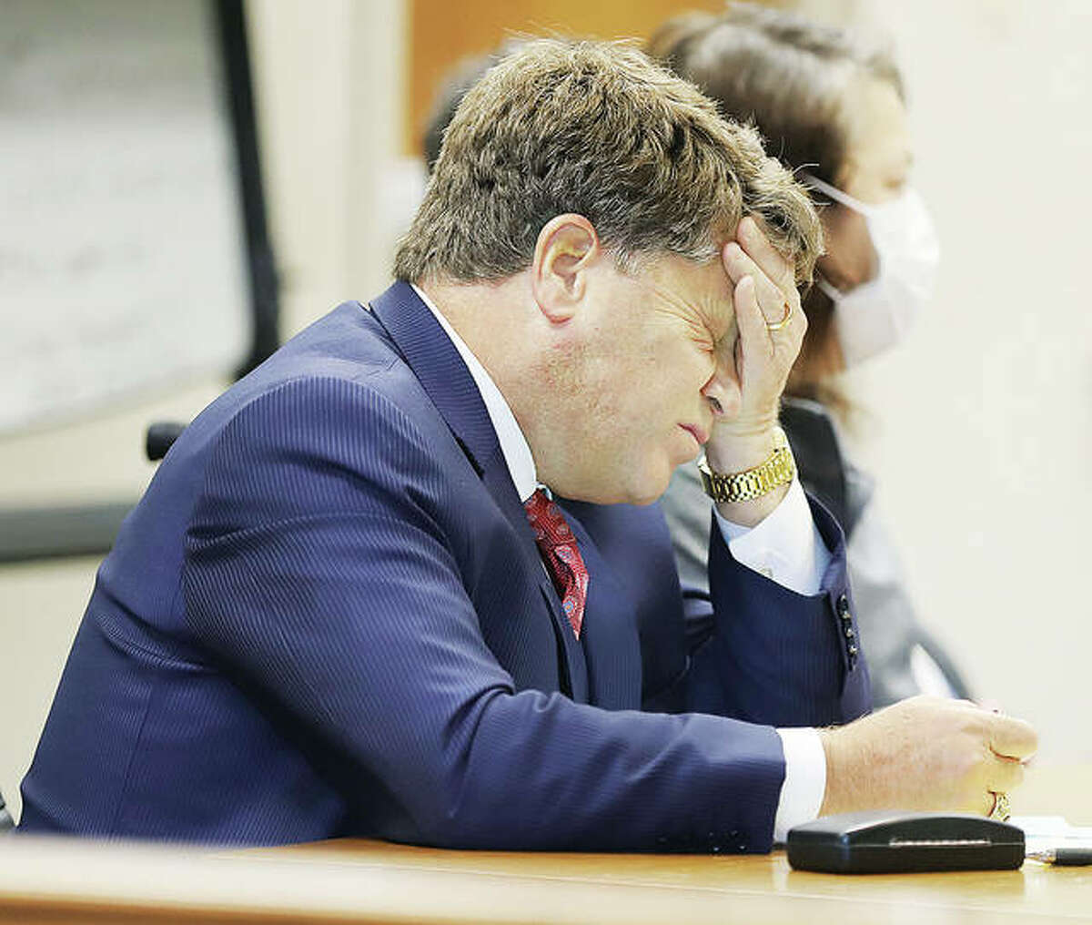 John Stobbs, one of the defense attorneys for Amber Hampshire, rubs his face as testimony at the sentencing hearing dragged on through the noon hour Tuesday.
