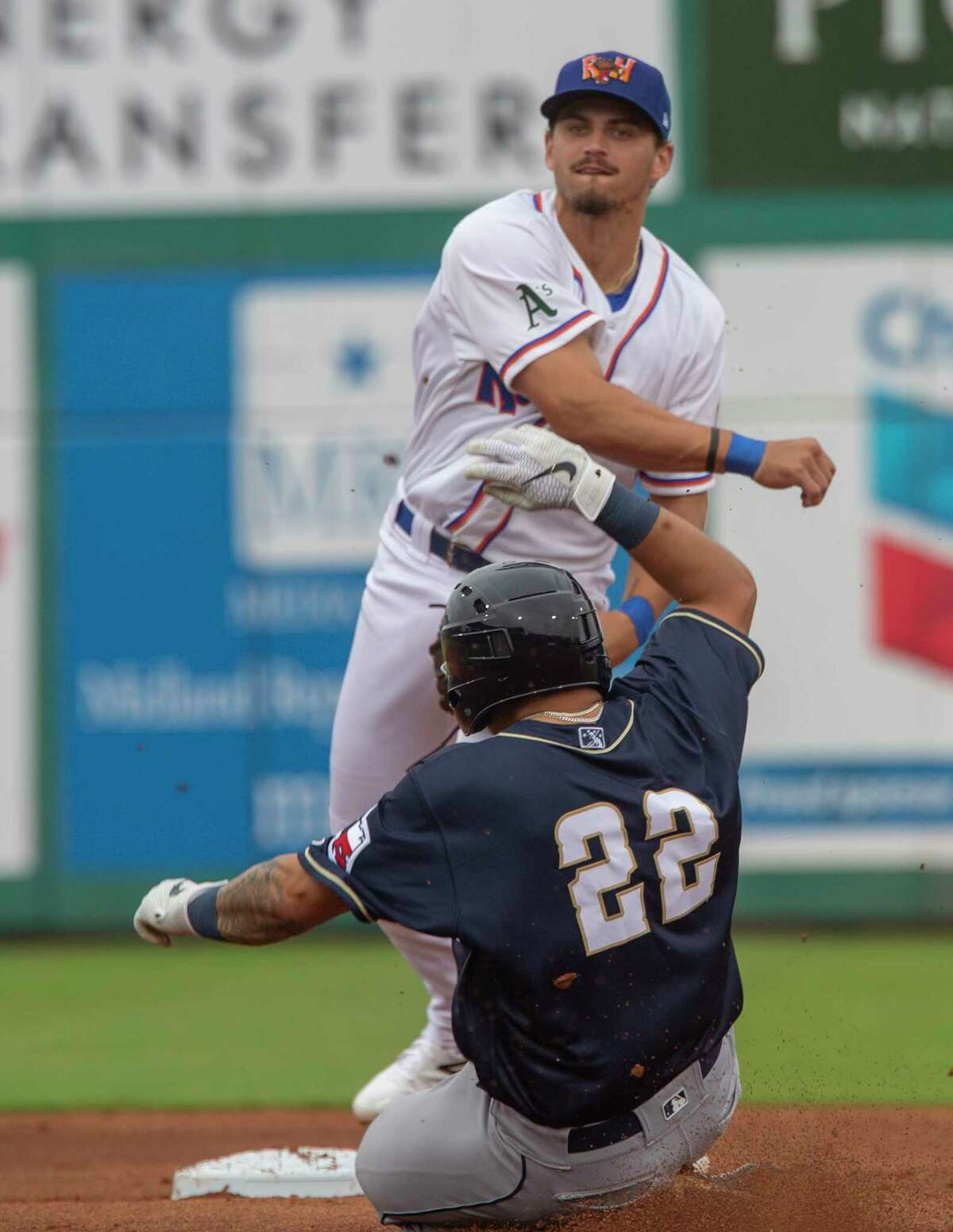 Midland RockHounds' Jeremy Eierman gets the force out at second on San Antonio Missions' Juan Fernandez and makes the throw to first to complate the double play 05/11/2021 at Momentum Bank Ballpark. Tim Fischer/Reporter-Telegram
