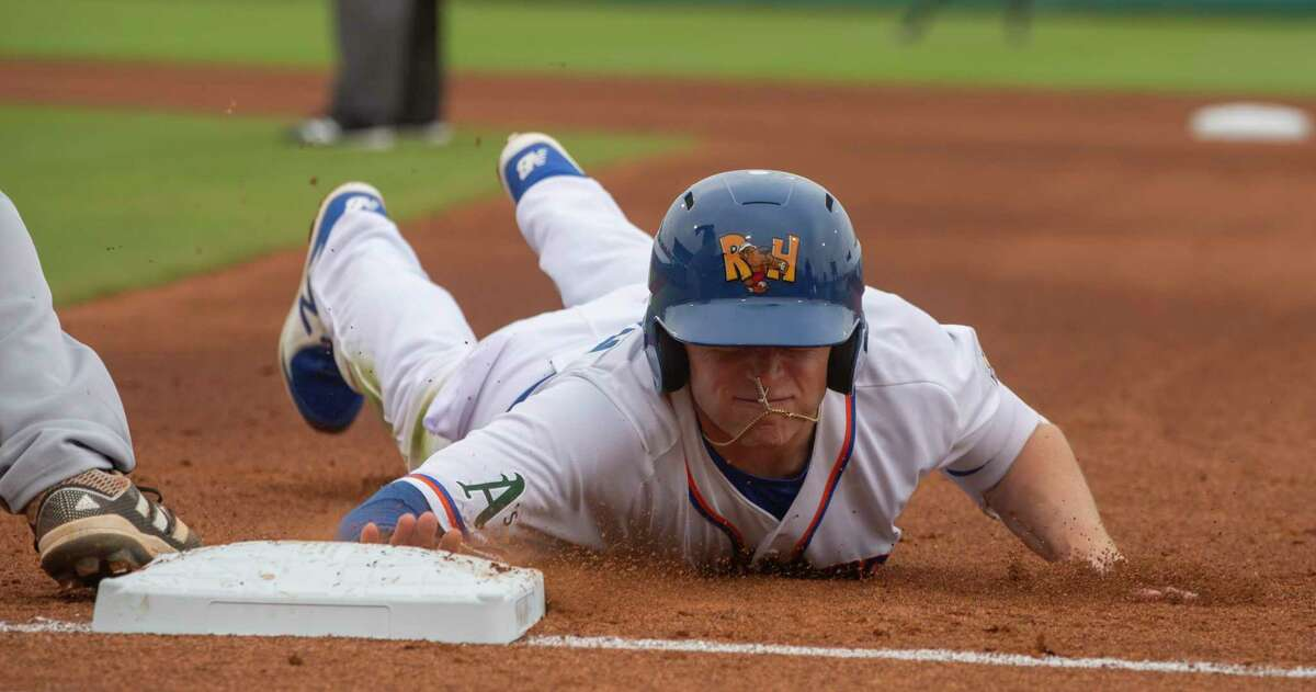Midland RockHounds' Nick Allen dives back to first on a pickoff attempt as San Antonio Missions' Taylor Kohlwey waits on the ball 05/11/2021 at Momentum Bank Ballpark. Tim Fischer/Reporter-Telegram