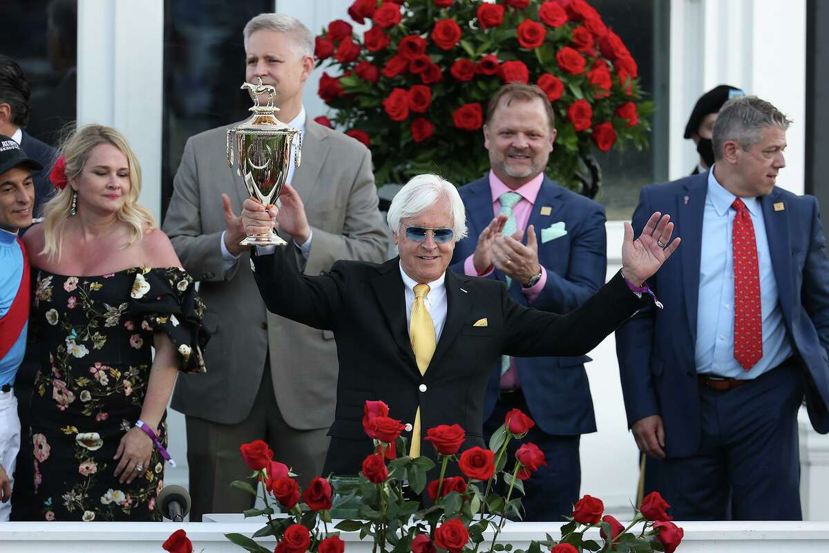 Trainer Bob Baffert of Medina Spirit, raises the trophy after winning the 147th running of the Kentucky Derby with Medina Spirit, his seventh career Kentucky Derby win, at Churchill Downs on May 01, 2021 in Louisville, Kentucky. (Andy Lyons/Getty Images/TNS)