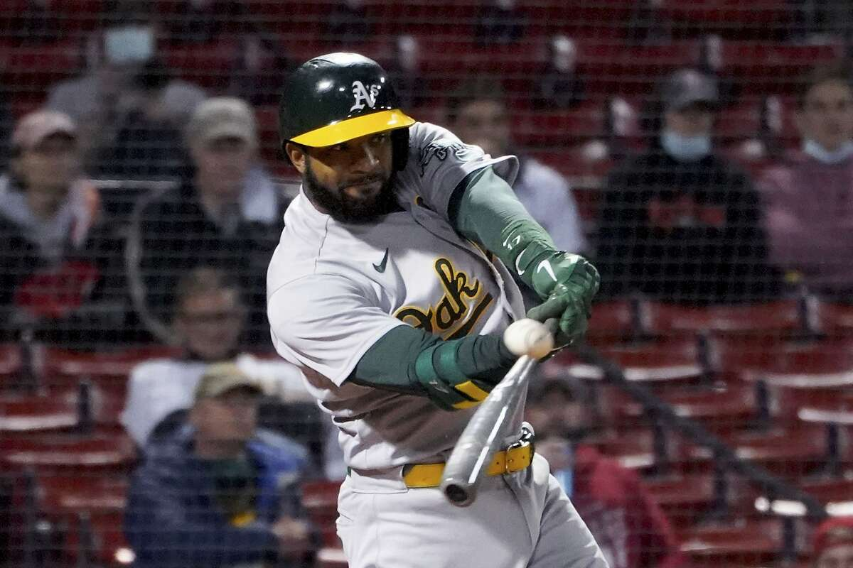 Oakland Athletics' Elvis Andrus hits a single to score Matt Chapman during the seventh inning of the team's baseball game against the Boston Red Sox, Tuesday, May 11, 2021, in Boston. (AP Photo/Mary Schwalm)