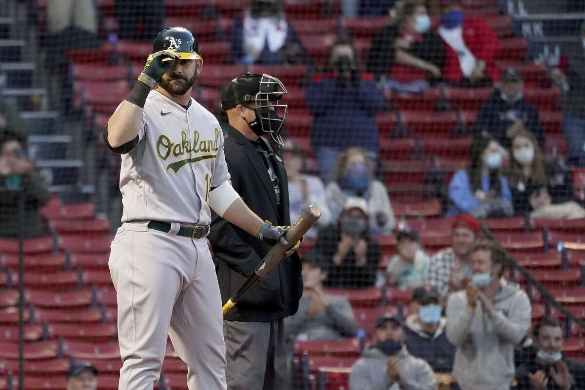 Oakland Athletics' Mitch Moreland (18), a former Boston Red Sox player, tips his cap to crowd in his first at-bat, during the second inning of the team's baseball game against the Red Sox, Tuesday, May 11, 2021, in Boston. (AP Photo/Mary Schwalm)
