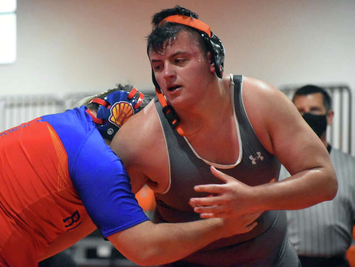 Edwardsville's Lino Gramaglia attempts to escape the hold of Roxana's Chase Allen in the 285-pound match.