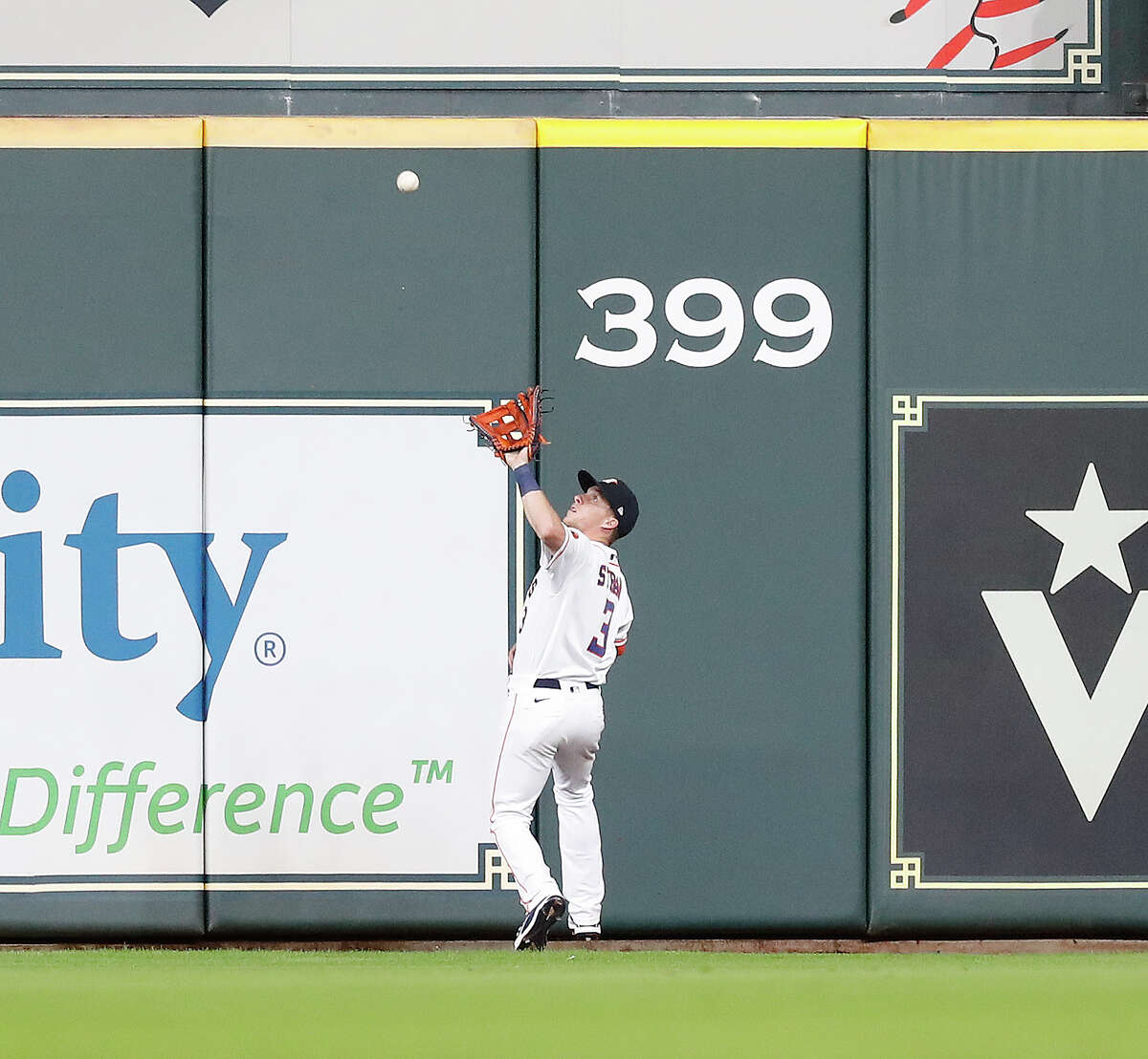 Houston Astros center fielder Myles Straw (3) goes back to catch Los Angeles Angels Mike Trout's fly out to end an MLB baseball game at Minute Maid Park, Tuesday, May 11, 2021, in Houston. Astros won the game 5-1.