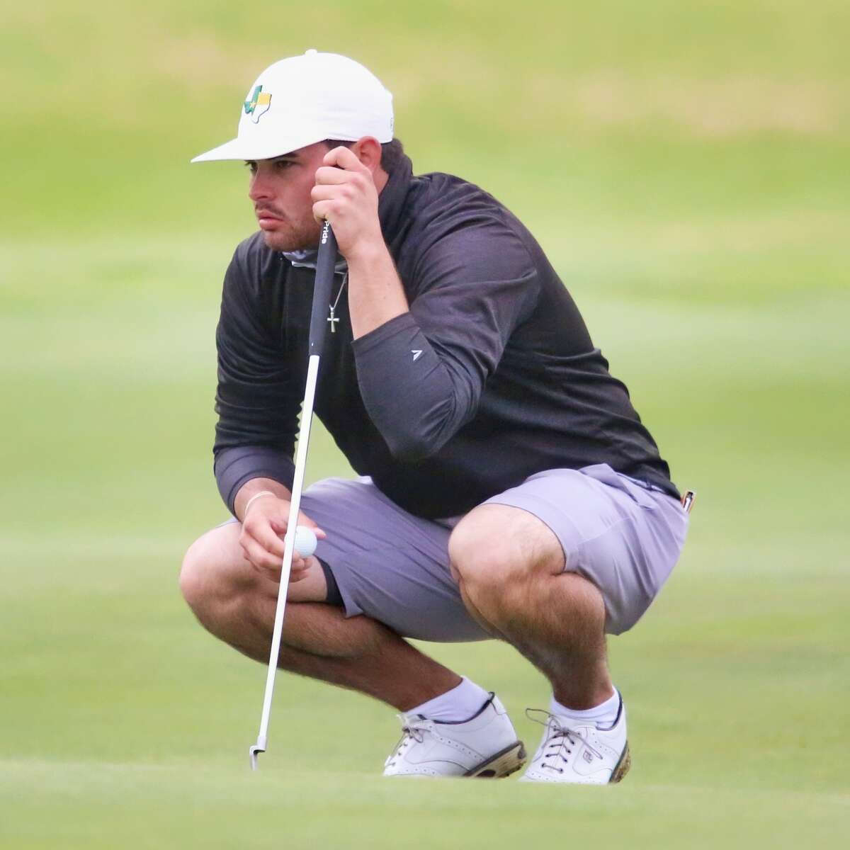 Midland College golfer JT Pittman surveys his shot during the second round of the NJCAA National Tournament at The Rawls Course in Lubbock on Tuesday.