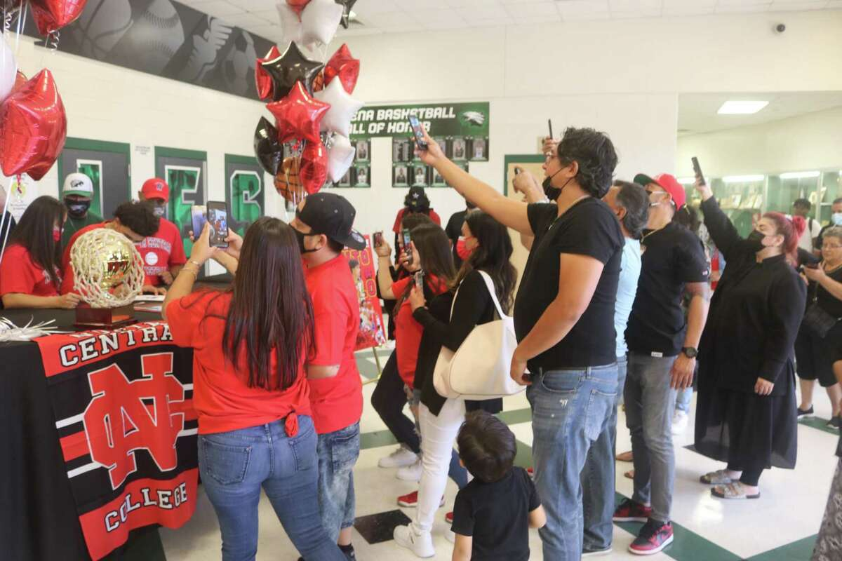 It was a sea of cell phones recording the moment Benito Tello inked with North Central College in Naperville, Ill.