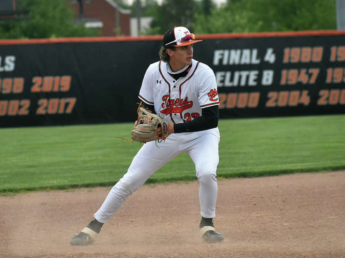 Edwardsville third baseman Spencer Stearns fires a throw over to first base for an out in the first game against Granite City on Tuesday.