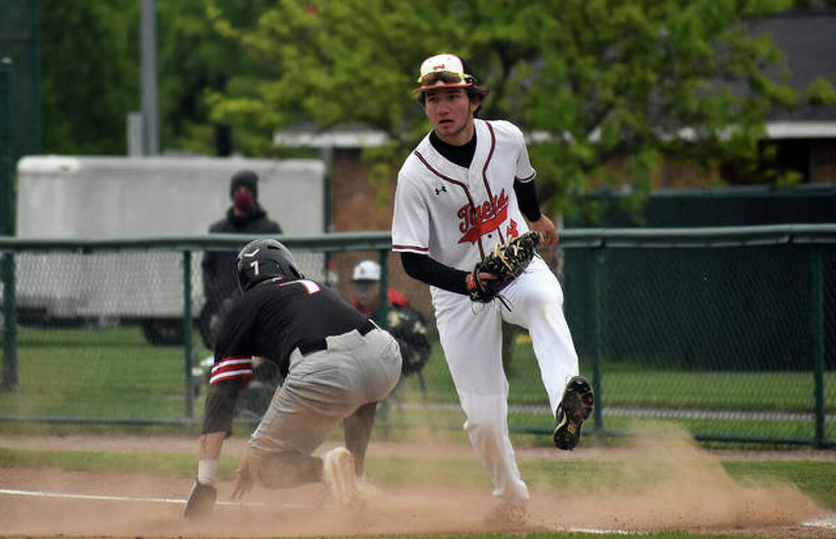 Edwardsville first baseman Riley Iffrig heads to the dugout after a double play ended the inning in the first game against Granite City on Tuesday.