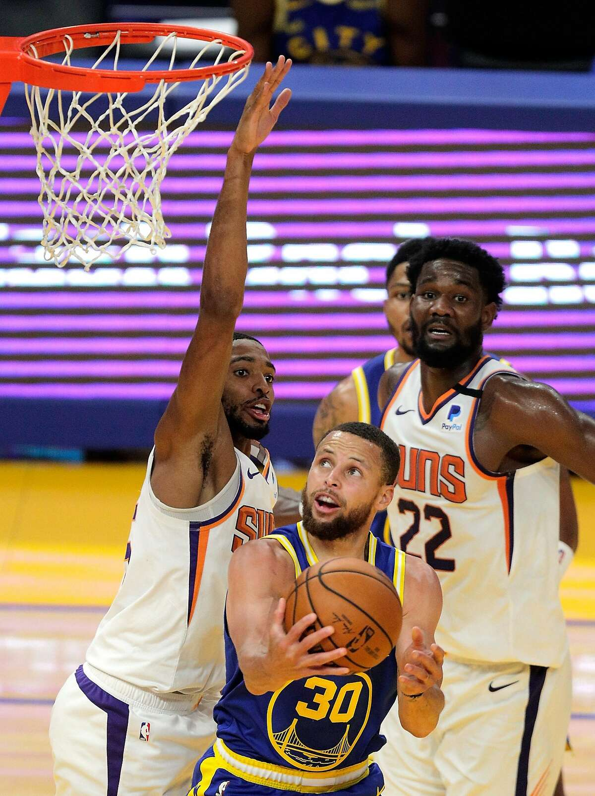 Stephen Curry gets under Mikal Bridges and is fouled on the basket in the second half. Curry had 21 points.