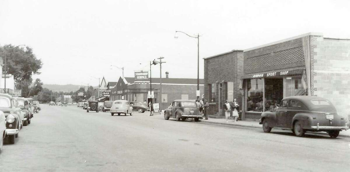 East side of Main Street in Beulah looking north, featuring the Bowman Sport Shop, Benzie Record newspaper office, Standard service station and Ten-Pin bowling alley,about 1949. (Courtesy Photo)