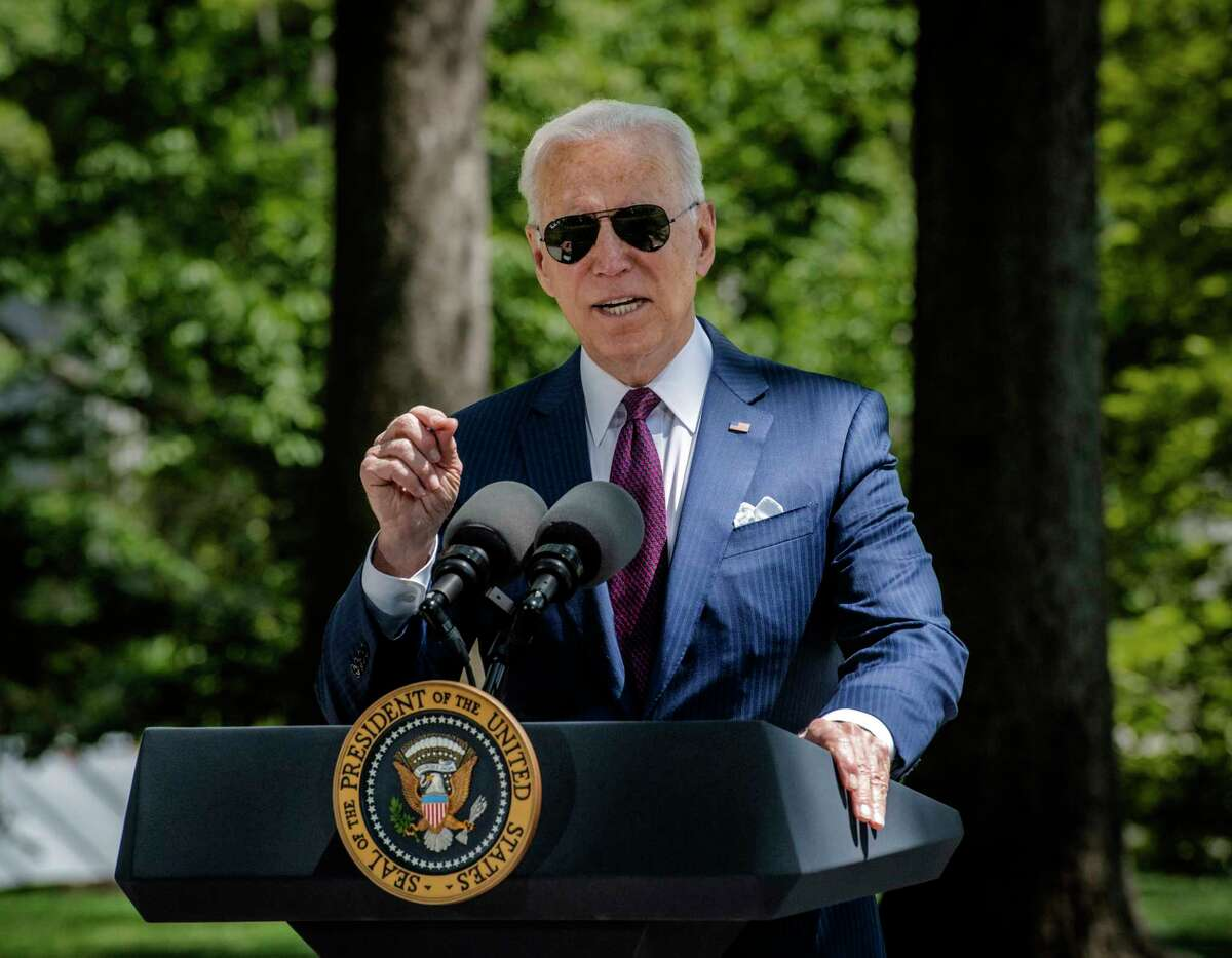 President Biden steps back to the podium after delivering remarks on the White House front lawn on April 27, 2021.