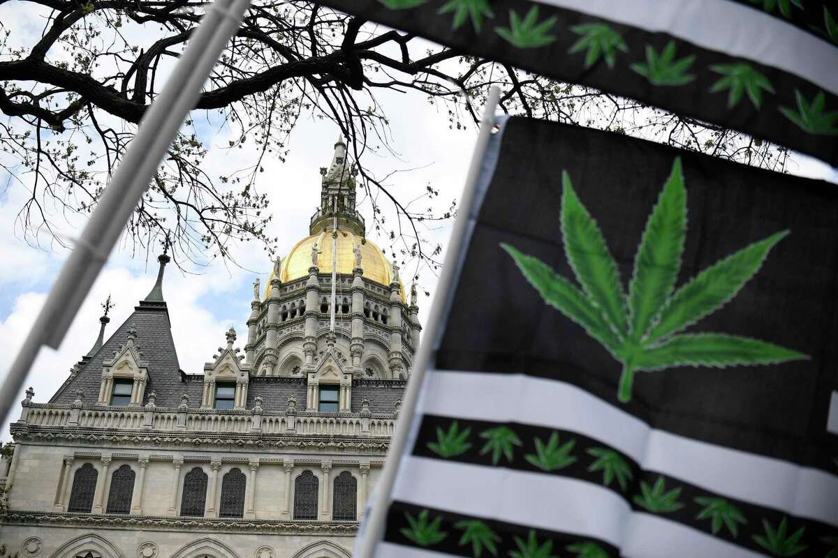 Flags with a marijuana leaf wave outside the Connecticut State Capitol building, Tuesday, April 20, 2021 in Hartford, Conn.