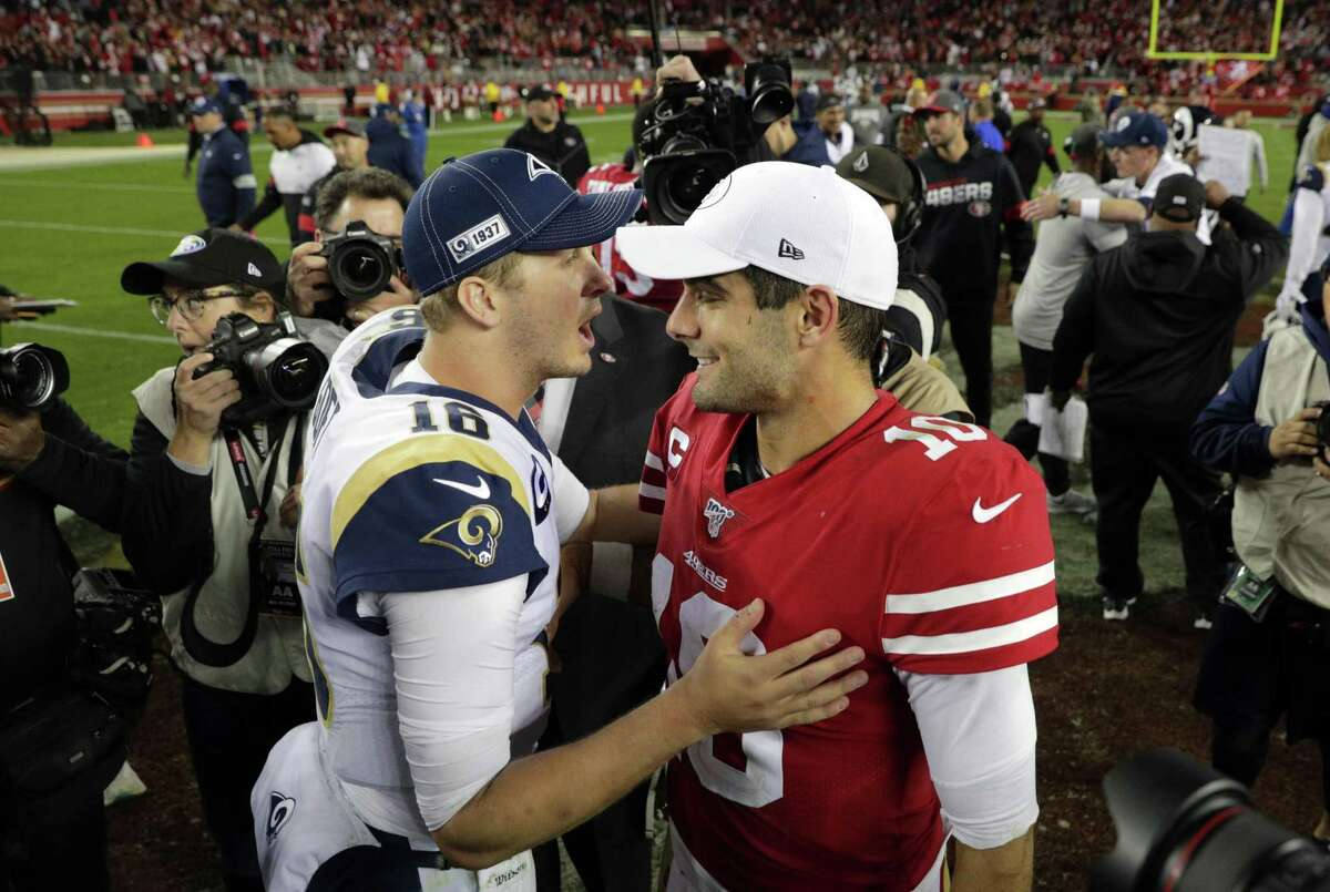 Jared Goff (left) and Jimmy Garoppolo talk after the 49ers' 34-31 win over the Rams on Dec. 21, 2019, at Levi's Stadium.