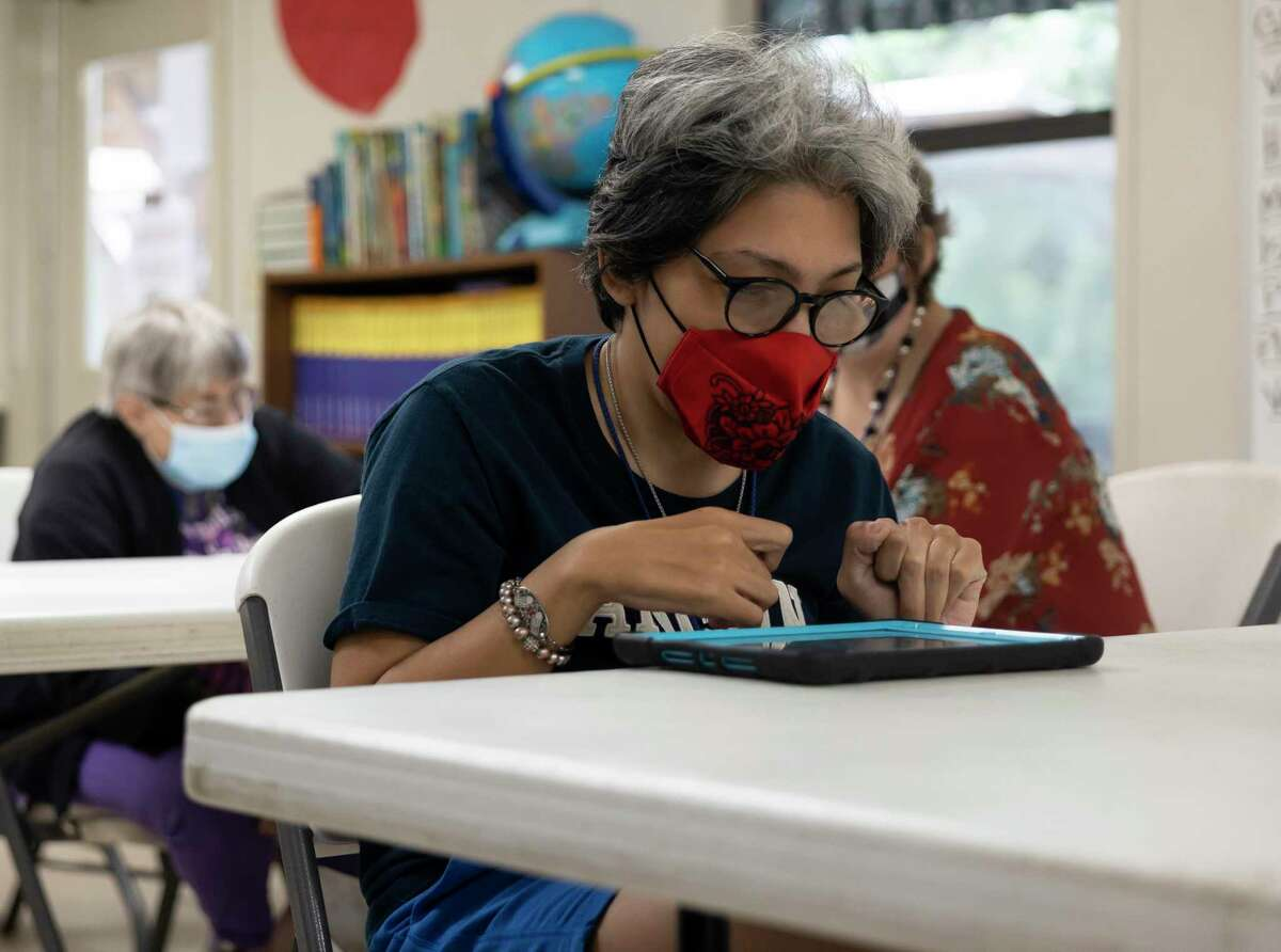 Melinda Bubela practices a science activity on a tablet during an adult continuing education class at Bridgewood Farms, May 11, 2021, in Conroe. The non-profit was without water since winter storm Uri due to damage done to their water well system.