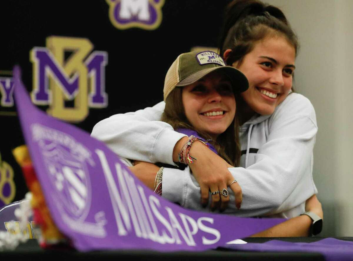 Ranee Levasseur gets a hug from Zoey Prelli after signing to play soccer for Millsaps College during a signing ceremony, Wednesday, May 12, 2021, in Montgomery.