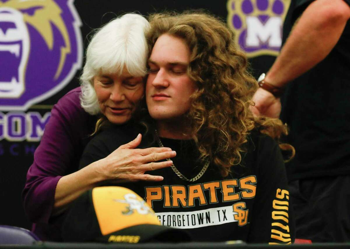 Trey Terna gets a hug from his grandmother, Brenda Anderson, after signing to play football for Southwestern University during a signing ceremony, Wednesday, May 12, 2021, in Montgomery.