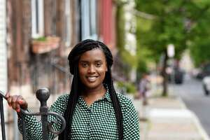 Virginia Rawlins is pictured on First Street on Monday, May 10, 2021, in Albany, N.Y. Rawlins is the founder of a real estate company that aims to increase homeownership among people of color in the city. (Will Waldron/Times Union)