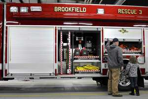 Brookfield Volunteer Firefighter Ken Baylor gives a tour of the firehouse to his daughter Grace, 7, during an open house on Saturday. The open house was to celebrate Volunteer Firefighter Day and the start of National Volunteer Week (April 10-16). April 9, 2016, in Brookfield Conn.